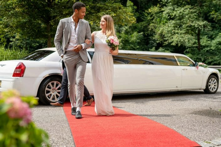 bridal couple with limousine