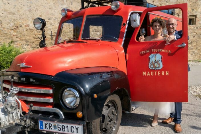 bridal couple with fire truck