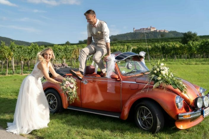 bridal couple in vw beetle